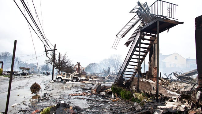 Homes and vehicles in Sandy Point, in Queens, New York, were destroyed by high winds and a fire triggered by Hurricane Sandy in 2012.
