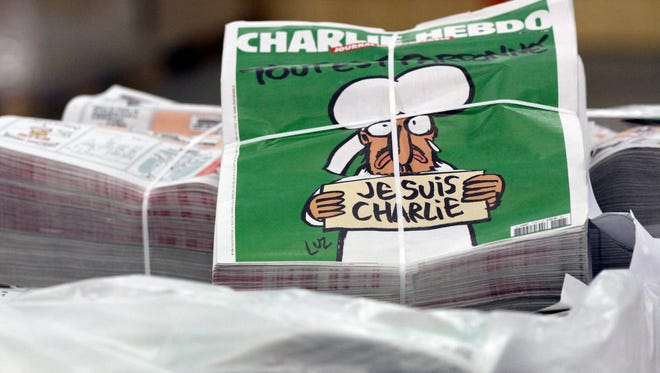 Copies of the upcoming edition of the French satirical magazine Charlie Hebdo are stacked at a distribution centre in Nantes, France, Jan. 2015. Charlie Hebdo will feature cartoons of the prophet Muhammad in its next edition, to be published on 14 January. It will have a print run of 3 million, up from an earlier announced run of 1 million, and far in excess of the weekly magazine's usual circulation of 60,000. The cover shows a turbanned man weeping under the caption 'All is forgiven,' in French, holding a sign saying 'I am Charlie,' according to a draft published by Liberation daily online.