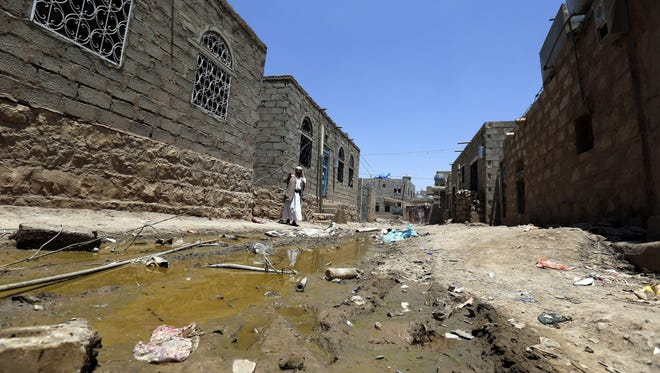 A Yemeni man stands at a deserted neighborhood after its population fled due to airstrikes allegedly carried out by a Saudi-led coalition against a Houthi rebels' position in Sana'a, Yemen, on April 2, 2015.