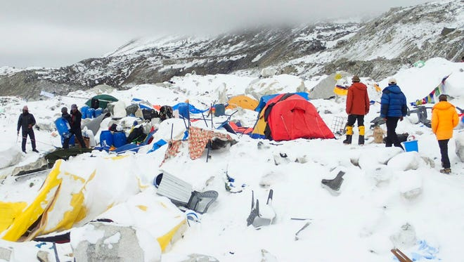 Dozens of tents lie damaged after an avalanche plowed through Mount Everest base camp,  killing at least 18 people following the 7.9-magnitude earthquake in Nepal.