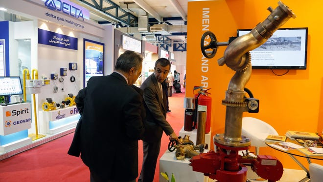 People visit the 20th Iran Oil, Gas and Petrochemical International Exhibition in Tehran May 6, 2015. About 600 major energy companies from 32 countries took part in the annual international event.