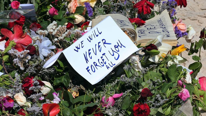 epa04822465 Flowers and cards are placed in tribute to the victims of a terror attack on a beach in front of the imperial Marhaba Hotel in Sousse,Tunisia, 28 June 2015. According to local reports 26 June, an assailant with handgrenades opened fire on tourists at two hotels, killing at least 37 people, including Germans, Brits and Belgians, and wounding several others, some while they were sunbathing, the attacker was killed later in a gun fight with Tunisian security services, while people beleieved to be associated with him have since been arrested in the country. The group which calls itself the Islamic State (IS) have claimed responsibility.  EPA/MOHAMED MESSARA ORG XMIT: SOU09