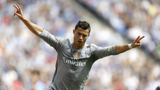 Real Madrid's Cristiano Ronaldo celebrates his first goal during the Primera Division match against Espanyol.