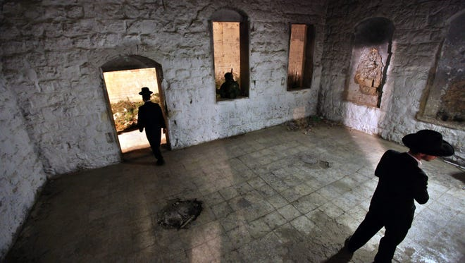 A 2010 photo of ultra-Orthodox Jews walking through the compound of Joseph's Tomb in the West Bank city of Nablus.  A group of Palestinians have set fire to Joseph's Tomb in Nablus in the occupied Palestinian West Bank, according to the Israeli army.