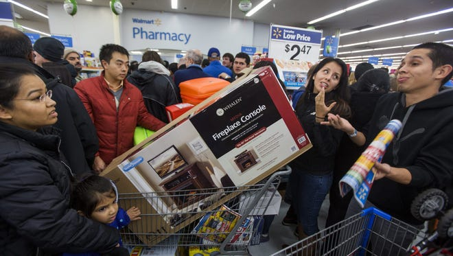 """FILE: Bargain hunters crowd a Walmart to take advantage of their """"Black Friday' sales on Thanksgiving Day in Fairfax, Virginia  in 2014."""