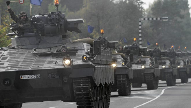 German Bundeswehr soldiers on fighting vehicles train in Riga, Latvia, in October. Germany is considering the deployment of 1,200 troops to help fight the Islamic State.