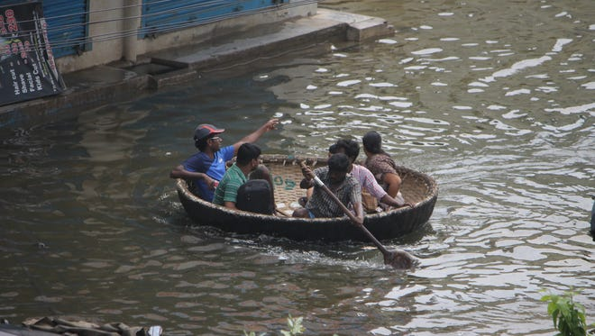 People are being rescued from their flood-affected houses with the help of  'coracle', a small round boat made of bamboo and tar sheets in Chennai, India, Dec. 4, 2015. The death toll in the floods has reached 325 with rescue workers evacuating some 10,000 people from the flood hit Chennai.