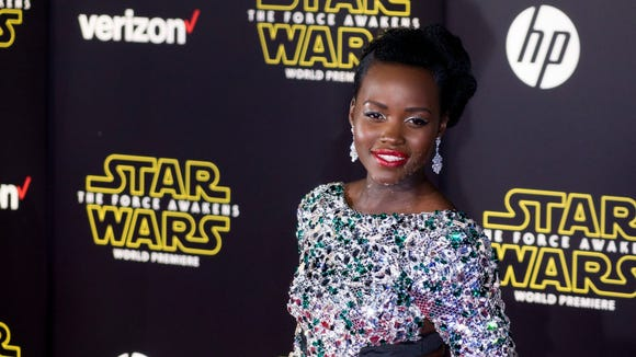 Lupita Nyong'o poses on the red carpet during the world