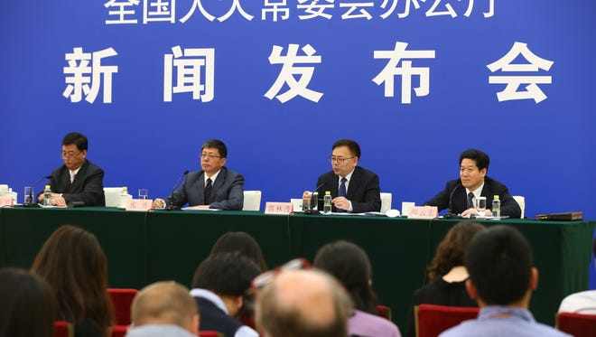 (L-R) Liu Zhenyu, Vice-Minister of Ministry of Justice, Zhang Yong, Vice-Director, Legislative Affairs Commission of standing committee of the National People's Congress, Guo Linmao, inspector of social law department, Legislative Affairs Commission of standing committee of the National People's Congress and Hao Yunhong, director of overseas non-governmental organizations department of the Ministry of Public Security, attend the press conference held by the General Office of the Standing Committee of the National People's Congress (NPC) at Great Hall of the People (GHOP) in Beijing, China, on April 28, 2016.