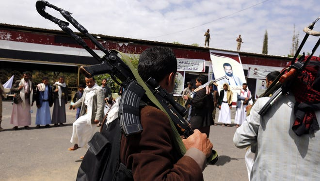 Houthi supporters visit a picture exhibition of late Houthi fighters allegedly killed in Yemen's ongoing conflict, in Sana'a, Yemen, on May 5, 2016.
