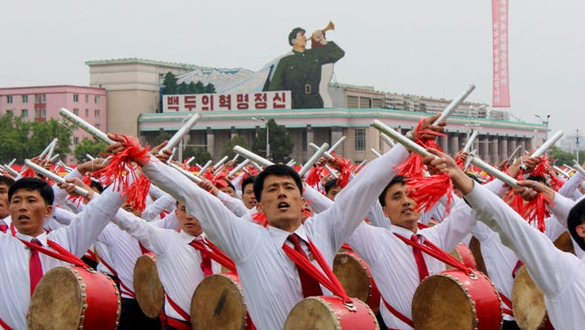 Drummers take part in a mass parade during the closing ceremony of the Workers' Party Congress in Pyongyang, North Korea, on May 10, 2016.