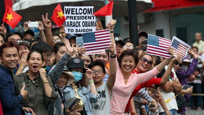 Vietnamese wait for U.S. President Barack Obama outside the Jade Pagoda in Ho Chi Minh City, Vietnam, May 24, 2016.