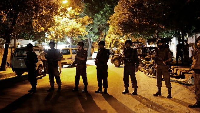 Bangladeshi security forces stand guard as they seal off the streets close to a Spanish resturant, following a hostage taking, in Dhaka, Bangladesh, late 01 July 2016. Two police officials have been killed during the encounter while some gunmen reportedly took several people hostage, including some foreigners, inside a Spanish resturant. The law inforcement officials try to negotiate with the gunmen while the US-based SITE Intelligence Group quoted the Amaq News Agency as saying that fighters of the terrorist organisation 'Islamic State' (IS) carried out the attack.