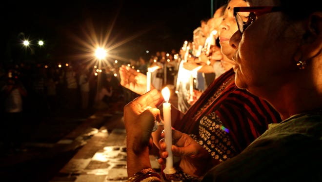 People attend a candlelight vigil to those  killed in a terrorist attack at the Holey Artisan Bakery, in Dhaka, Bangladesh.