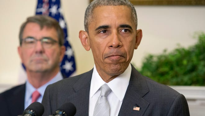 President Obama announces he will leave more troops in Afghanistan than previously planned, beside Defense Secretary Ash Carter, left, in the Roosevelt Room of the White House on July 6, 2016.
