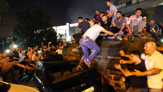 People occupy a tank in Istanbul, Turkey, on July 16, 2016.