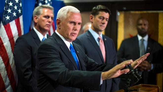 Mike Pence, along with Speaker Paul Ryan and House Majority Leader Kevin McCarthy, speaks to the media in the lobby of the Republican National Committee headquarters in Washington on Sept. 13, 2016.