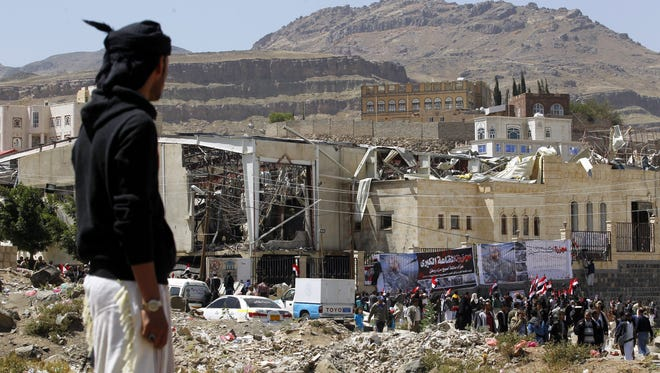 Yemenis take part in a rally in solidarity and honor of the victims of Saudi-led airstrikes targeting a funeral hall a week ago, outside the destroyed hall in Sana'a, Yemen, on Oct. 15, 2016.