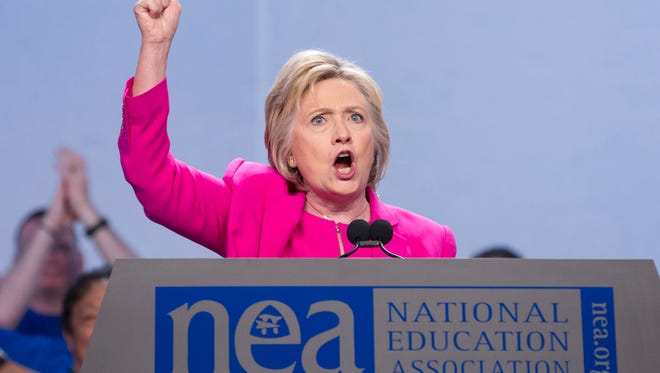 epa05409232 Democratic presidential candidate Hillary Clinton addresses the National Education Association's 95th Representative Assembly in Washington, DC, USA, 05 July 2016. NEA is the largest labor union in the United States.  EPA/MICHAEL REYNOLDS