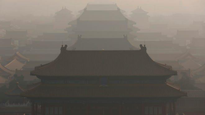 Haze envelops the Forbidden City in Beijing, China, on Dec. 19, 2016.