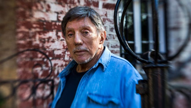 A file photo from 2013 shows author and screenwriter Wlliam Peter Blatty of 'The Exorcist' fame in the Georgetown neighborhood of Washington.