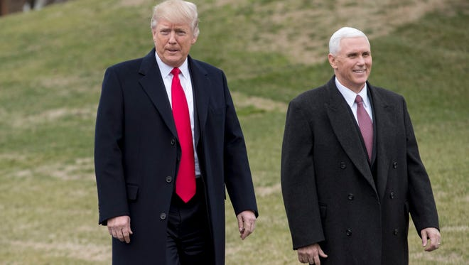 President Donald J. Trump and Vice President Mike Pence walk on the South Driveway of the White House to greet Harley Davidson executives and union representatives  Feb. 2, 2017.