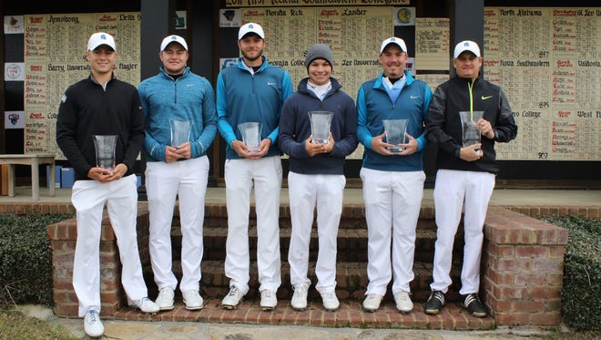 The UWF men's golf team poses with their latest trophy after winning in Savannah, Georgia.