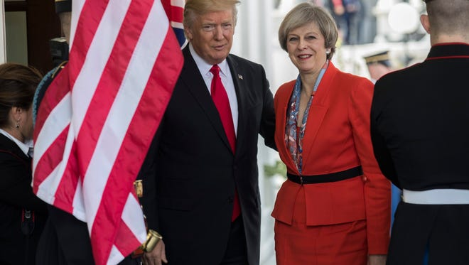 President Trump is pictured greeting British Prime Minister Theresa May as she arrived at the White House earlier this year.