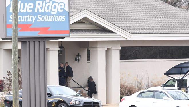 Authorities responded to a report of a bomb threat at Priority One Security, a former Blue Ridge security location where the sign has not been updated.
