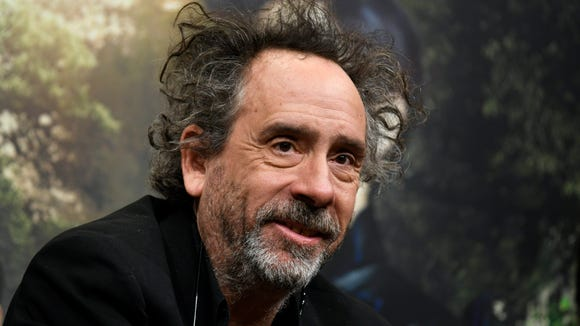 Director Tim Burton attends a press conference promoting