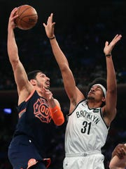New York Knicks center Enes Kanter (00) puts up a shot against Brooklyn Nets center Jarrett Allen (31) during the first quarter of an NBA basketball game, Tuesday, Jan. 30, 2018, in New York. (AP Photo/Julie Jacobson)