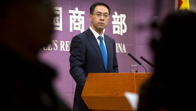 In this March 29, 2018, photo, Chinese Ministry of Commerce spokesman Gao Feng listens to a reporter's question during a press conference at the Ministry of Commerce in Beijing.
