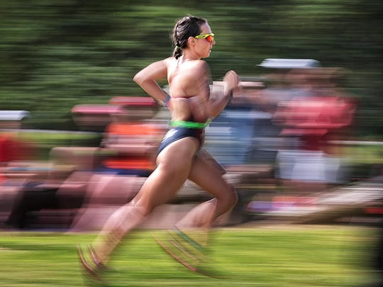 Laura Mathews finishes up the final leg of the 35th annual Memphis In May Triathlon at Orgill Park in Millington.