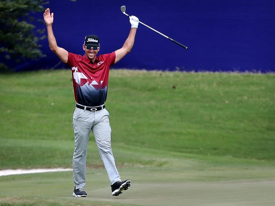 Rafa Cabrera Bello celebrates after holing out on the