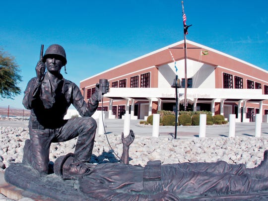The Robert E. Bush Naval Hospital stands behind a statute of its namesake at the Marine Corps Air Ground Combat Center in Twentynine Palms. Bush earned the Medal of Honor during the during the Battle of Okinawa in World War II.