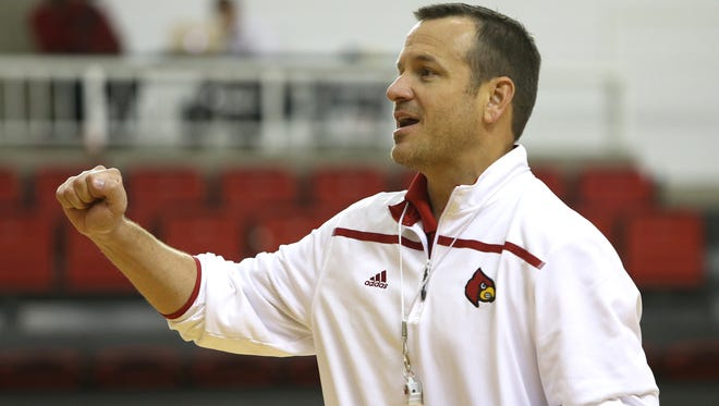 UofL Women's Basketball Coach Jeff Walz talks to his players during practice.