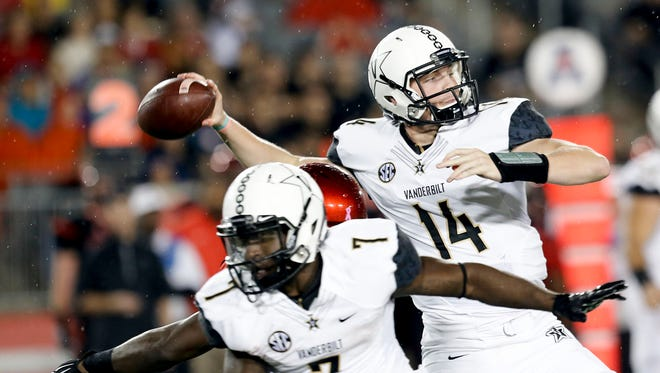 Vanderbilt quarterback Kyle Shurmur (14) is available to play against Kentucky Saturday after sitting out last week's loss at Florida.