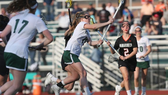 Yorktown's Kelsey McDonnell (15) fires a shot for a