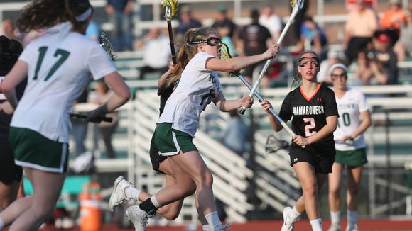 Yorktown's Kelsey McDonnell (15) fires a shot for a second half goal against  Mamaroneck during girls lacrosse action at Yorktown High School April 13, 2018. Yorktown won the game 7-6.