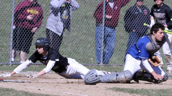 Ossining's Peter Bossinas scores the go ahead run in