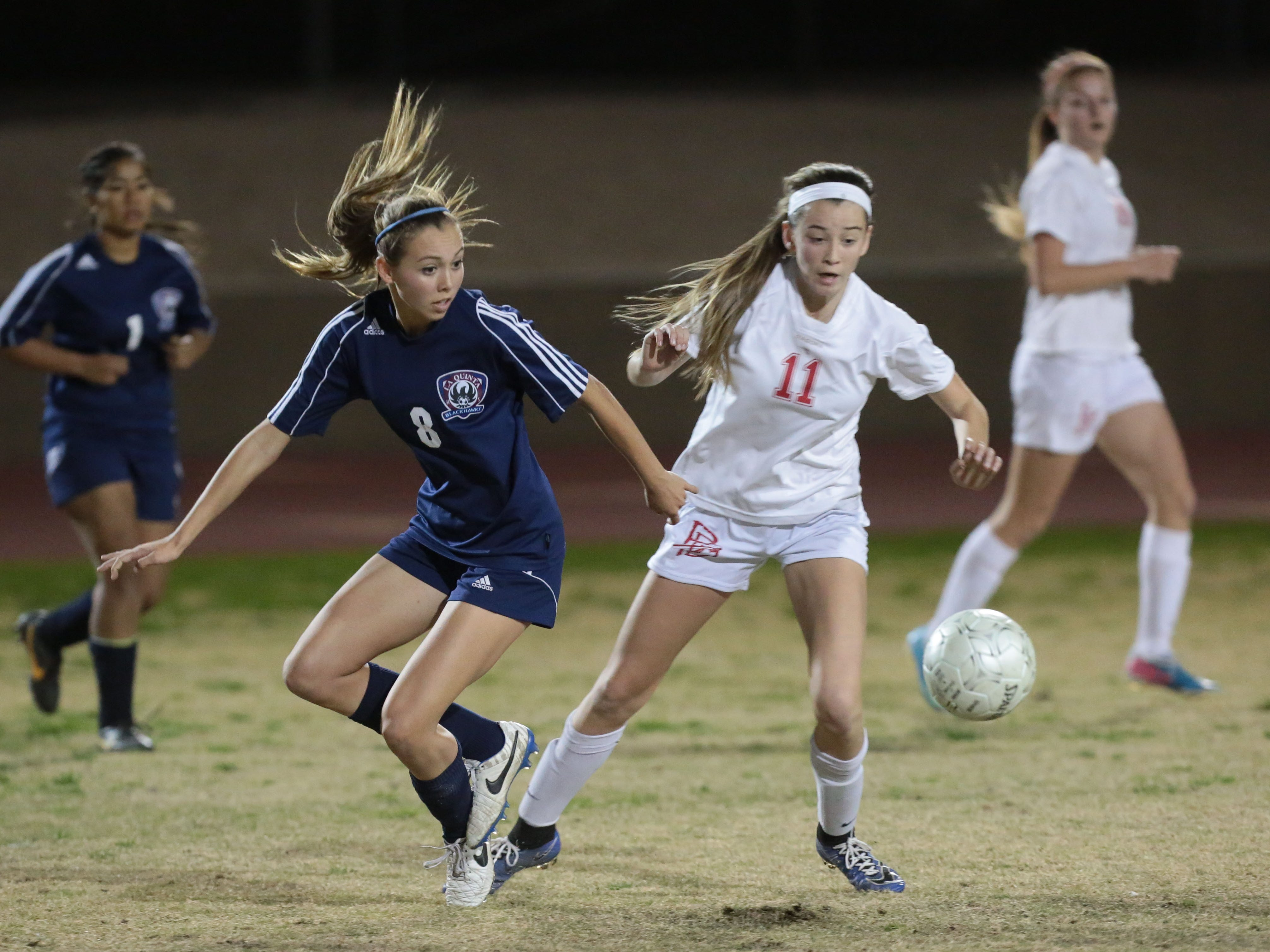 La Quinta's Jaylene Manion and Palm Desert's Alyssa Granados fight for the ball in the first half Wednesday in Palm Desert. The Blackhawks won 1-0.