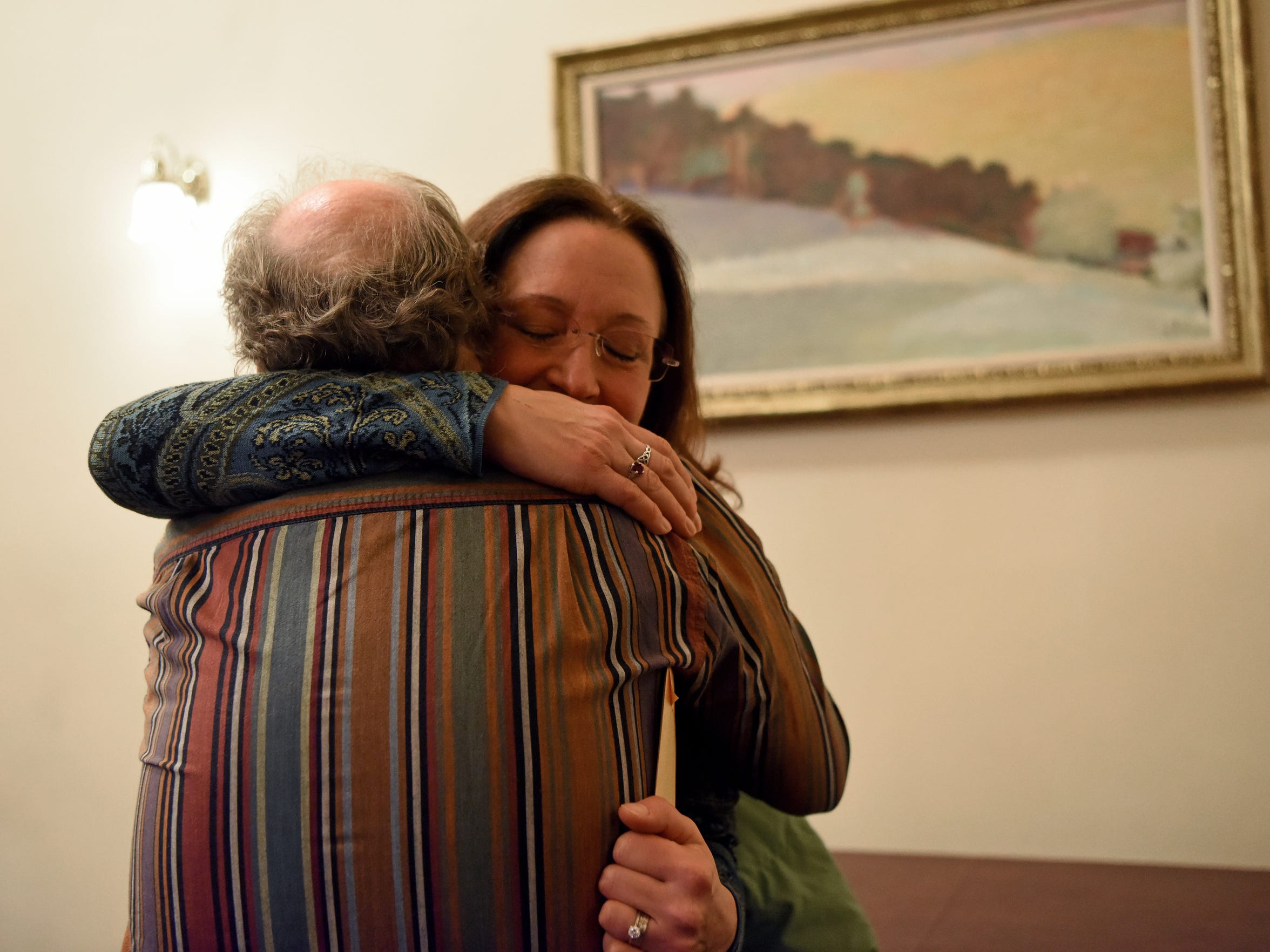 Adoptee Theresa Carroll of East Islip, NY, hugs her