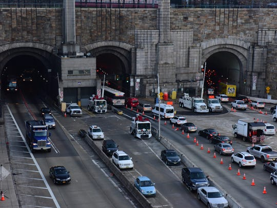 Commuters traveling through the Lincoln Tunnel on January
