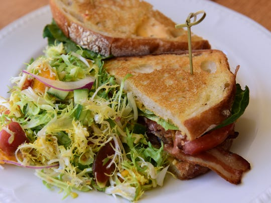 Thick bacon strips, pimento cheese and roasted garlic aioli add oomph to the BLT at Mathews.