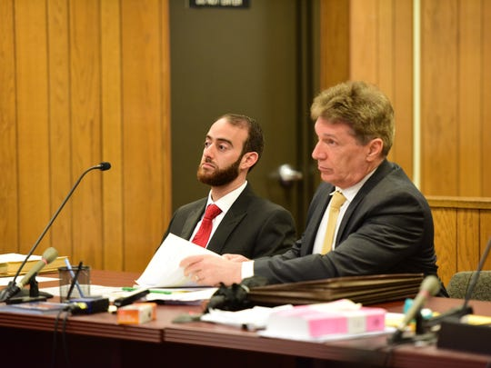 Issa Abbasi, Teaneck Clerk, sits next to his attorney Thomas B. Hanrahan as Elie Jones dismissed with prejudice his criminal complaint before Judge Roy McGeady Thursday morning May 25, 2017.