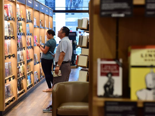 Customers browse at Amazon Books, which opened at Westfield