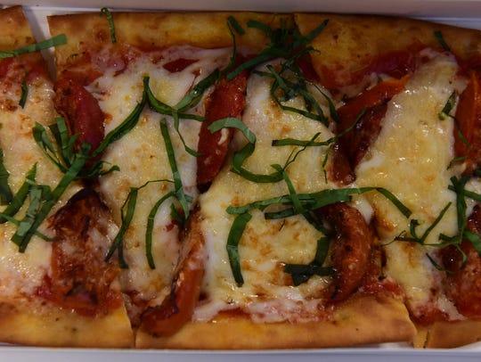 Caprese Flatbread, $11.99, roasted tomatoes, parmesan