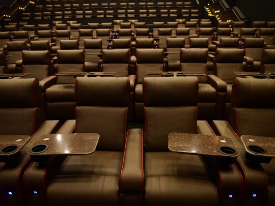 Reclinable seats with trays for eating at the AMC,