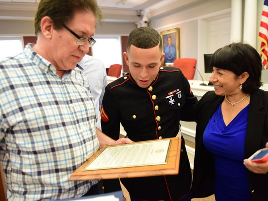 At center David Carr, a Marine Corps Lance Corporal