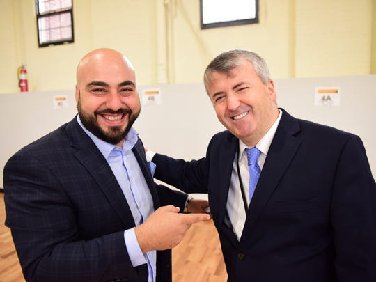From left, School Director and principal Danny Necimo and iLearn School CEO Nihat Guvercin at the ribbon cutting ceremony. iLearn Schools held its Grand Opening today at a newly refurbished mill in Paterson that is new home for the Paterson Arts and Science charter school.